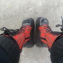 [image description: platform black and plaid boots, black tall socks]