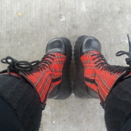 [image description: platform black and plaid boots, black tall socks]