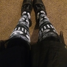 [image description: looking down at Jack Skellington fair isle socks and Mary Jane Shoes]